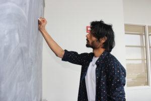 Aditya Singh writing on blackboard