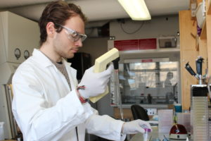 Student using glass pipette in the lab