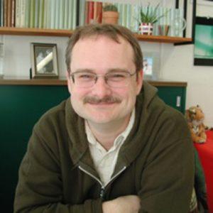 Headshot image of Prof. John Berry